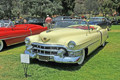 Cadillac Eldorado. This is a 1953 Cadillac Eldorado convertible with white wall tires. Surprisingly, this car only seats three people inasmuch as there is no stock photo