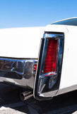 Cadillac Eldorado. Rear detail with lamp and exhaust of white Cadillac Eldorado Royalty Free Stock Photos