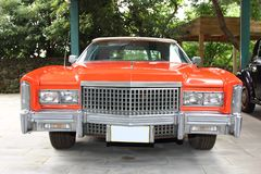 Cadillac Eldorado, 1975 year, USA, orange color, front view. Cadillac Eldorado, 1975 year, USA, orange color. The island of Jeju. Korea stock photo