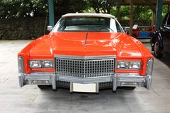 Cadillac Eldorado, 1975 year, USA, orange color, front view. Cadillac Eldorado, 1975 year, USA, orange color. The island of Jeju. Korea royalty free stock photo