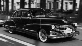 Cadillac of the fifties in black and white. A sideways shot of a fifties Cadillac driving in Ghent, Belgium. Black and white Stock Photo