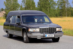 Cadillac Fleetwood Funeral Vehicle Driving Along Rural Road stock photo