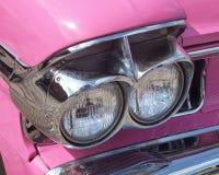 Cadillac headlights. Headlights on vintage pink Cadillac royalty free stock photo