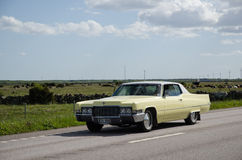 Cadillac old timer on the road. OLAND, SWEDEN - MAY 23, 2015: Classic car Cadillac de Ville, 1969, on the road heading for an old timer car meeting at the Stock Photo