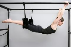 Cadillac pilates sport woman gym instructor. Fitness exercise Stock Image