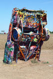 Cadillac Ranch. A view of Cadillac Ranch in Amarillo, Texas. Cadillacs are buried nose down in the ground and tourists spray paint the cars so that they look Royalty Free Stock Photos