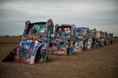 The Cadillac Ranch, along Historic Route 66 in Amarillo, Texas. Grungy, colorful. royalty free stock photography