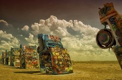 Cadillac Ranch in Amarillo, Texas. Blossoming cumulus clouds are seen behind the Cadillac Ranch just west of Amarillo, Texas along Interstate 40. This is a Stock Photos