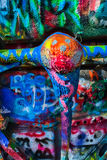 Cadillac Ranch Graffiti Painted Undercarriage. Cadillac Ranch outside Amarillo Texas, Cadillac undercarriage covered with many thick coats of brightly colored Royalty Free Stock Images