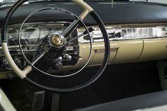 Cadillac Series 62 De Ville steering wheel and dashboard Royalty Free Stock Image
