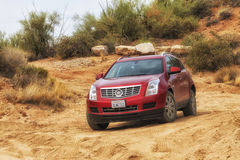 Cadillac SRX driving in the Arizona Desert. Cadillac SRX driving in the Arizona's Desert at Apache trail scenic drive Stock Photos