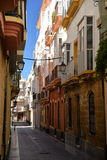 Cadiz, Andalusia, Spain. Traditional city centre alley Royalty Free Stock Photo