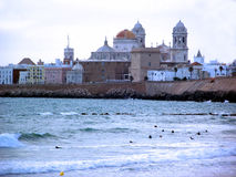 Cadiz beach and the Cathedral Royalty Free Stock Photo