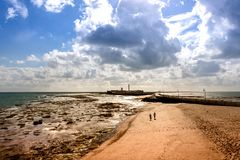Cadiz beach at lowtide. Sunny Cadiz beach at lowtide with a fort at the bottom Royalty Free Stock Image