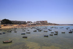 Cadiz beach with moored boats, in the south of Spain Stock Image