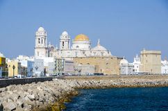 Cadiz cathedral and sea front promenade Royalty Free Stock Photos