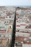 Cadiz city. Aerial view of narrow, straight street receding to coast, Cadiz town, Andalusia, Spain Royalty Free Stock Photography