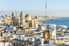 Cadiz cityscape with famous Cathedral, Andalusia, Spain. Cityscape with famous Cathedral of Cadiz by Atlantic Ocean, Cadiz, Andalusia, Spain Royalty Free Stock Image
