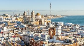 Cadiz cityscape with famous Cathedral, Andalusia, Spain. Cityscape with famous Cathedral of Cadiz by Atlantic Ocean, Cadiz, Andalusia, Spain Stock Photos