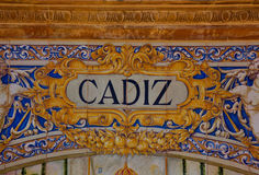 Cadiz sign over a mosaic wall Stock Image