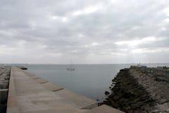 A pier in the sea bay of Cadiz. CADIZ, SPAIN - JULY 4, 2011: A pier in the sea bay of Cadiz Royalty Free Stock Photo