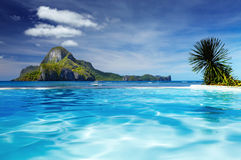 Cadlao island, El Nido, Philippines. Landscape with swimming pool and Cadlao island on background, El Nido, Philippines stock photography