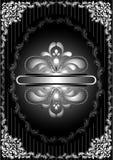Cadre argenté avec le décor à jour sur le fond noir rayé Photographie stock libre de droits