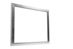 Cadre décoratif en aluminium de photo sur le fond blanc Photographie stock libre de droits