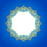 Cadre d'or sur un fond bleu abstrait Photo stock