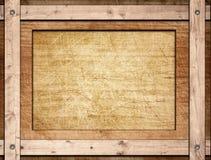 Cadre de Brown vissé sur le conseil en bois Image libre de droits