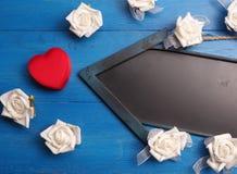 Cadre de cadeau en forme de coeur rouge Photo libre de droits