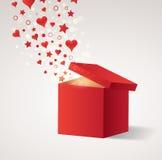 Cadre de cadeau ouvert avec des coeurs et des étoiles de vol Photographie stock