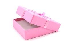 Cadre de cadeau rose ouvert avec une perle Photos stock