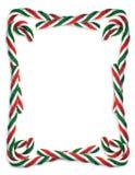 Cadre de canne de sucrerie de Noël Photographie stock
