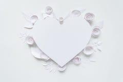 Cadre de coeur avec la fleur de livre blanc Images stock