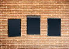 Cadre de menu de tableaux sur le fond de mur de briques images stock