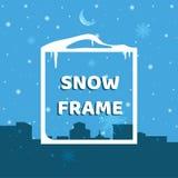 Cadre de neige sur le fond d'une ville d'hiver Photographie stock libre de droits