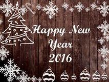 Cadre de Noël et de la nouvelle année 2016 sur le fond en bois Photo stock