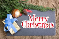 Cadre de Noël rustique avec le Joyeux Noël et la décoration des textes Image libre de droits