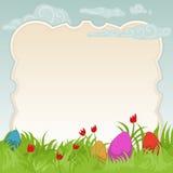 Cadre de Pâques avec les oeufs peints Photographie stock libre de droits