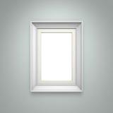 Cadre de tableau blanc sur le mur gris Photographie stock libre de droits