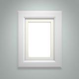 Cadre de tableau blanc sur le mur gris Image libre de droits