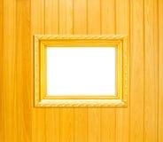 Cadre de tableau de cru d'or sur le fond en bois Photo libre de droits