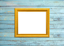Cadre de tableau de cru d'or sur le fond en bois bleu Photos stock