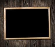 Cadre de tableau de cru sur le mur en bois Photographie stock libre de droits