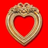 Cadre de tableau de forme de coeur sur le fond rouge Photo libre de droits