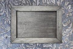 Cadre de tableau gris sur la texture de mur de ciment Photographie stock libre de droits