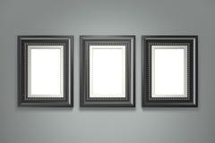 Cadre de tableau noir sur le mur gris Images stock