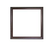 Cadre de tableau vide en bois ornementé d'isolement sur le fond blanc Image stock