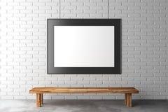 Cadre de tableau vide sur le mur de briques avec le banc en bois sur le béton Photographie stock